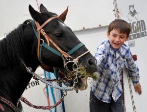 Kaleb Owens feeds his horse Tarbaby