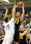 Jared Samuelson of West takes a shot over Jalen Whitley