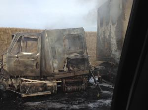 Semi catches fire on I-90 West, spilling fuel