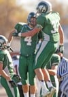 Central's Ryan Holden, 4, Dylan Hanser, 33, celebrate a touchdown