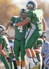 Central's Ryan Holden, 4, Dylan Hanser, 33, celebrate a touchdown