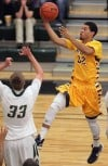 MSUB's David Arnold, 32 puts up a shot as Rocky's Joel Barndt, 33, defends