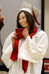 Keely Johnson shows off her diploma