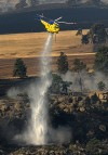 A Sikorski helocopter loaned to the firefighting effort