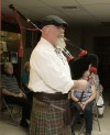 Rich Baldwin plays the bagpipes