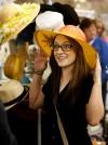 Triniti Halverson tries on a hat