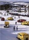 Snowcoaches and snowmobiles at Old Faithful