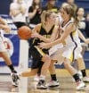 Maddy Shaide of Missoula Big Sky is defended