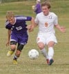 Senior's Strom Nuernberger, 9, and Butte's Blake Casagranda, 22, battle for the ball