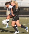 Senior's Blaque Saur 13, battles West's Haley Tessmer, 3, for the ball
