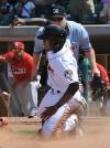 Phillip Ervin slides into home plate