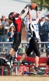 Huntley Project's TJ Harris, 3, battles Townsend's Alex Roberts