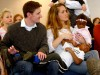 Ryan Duffy and Nina Hernandez sit with their children