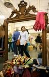 Mattie Clark is reflected in a mirror as she shops