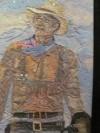 John Wayne portrait made of colored lint