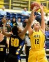 Alaska's Stephanie Toumson and MSUB's Quinn Peoples fight for a rebound