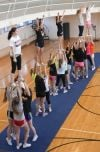 Cheerleaders practice a cheer