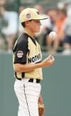 Big Sky pitcher Patrick Zimmer tosses a ball