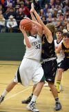 Micah Holt-Seavy drives against Laurel's Josh Anderson