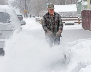 Snowfall tops 1972 record; NWS warns of difficult driving conditions