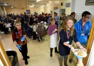 Mission possible: Volunteers serve Thanksgiving meals to 800 people at the Montana Rescue Mission