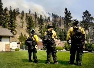 Crews work to halt wildfire from pushing east across Sleeman Gulch