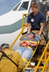 Billings firefighters carry out a student