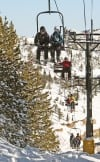 Skiers ride the lift