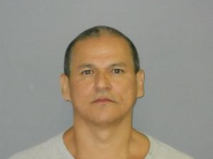 Man charged with assaulting wife