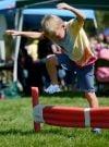 Kyler Thome enjoys the kid's croquet course