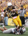 Wyoming quarterback Brett Smith slips the tackle