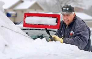 Winter storm keeps road crews hopping, sets snowfall record