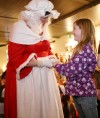 Katy O'Connor, 9, meets Mrs. Claus