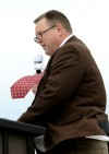 A blustery wind lifts U.S. Senator Jon Tester's tie