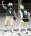 Rocky's Bryce Baker, 7, and Matt Concienne, 16, celebrate at touchdown