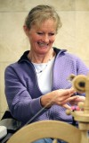 Gail Andren spins alpaca wool
