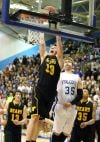 Jared Samuelson of West dunks the ball past Jameson Willems