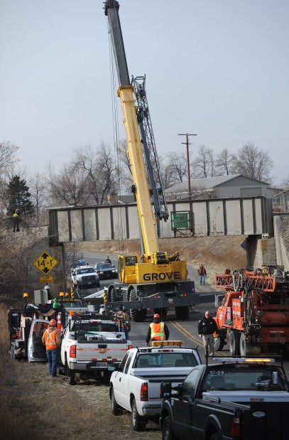 ... debris from highway 212 south of laurel after a crane being moved by