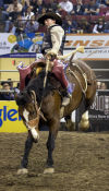 Ryan Mackenzie rides a saddle bronc