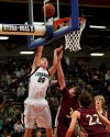 Austin Dayton of Columbus goes to the basket