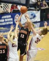 Chez Keehn of Billings Senior drives into the lane