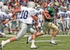 Rocky's Bryce Baker, 7, scrambles for yards as Dickinson's Sean Russell, 10, defends