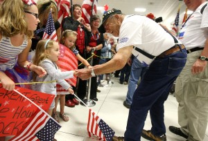 Flag-waving welcome greets Honor Flight vets