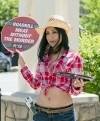 PETA cowgirl offers 'roadkill jerky' to downtown passersby