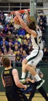 Billings Central's Jacob Hadley dunks