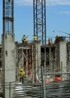 Workers construct an upper deck