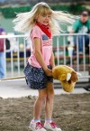 Halle Anderson, 5, rides a stick bull