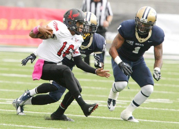 Eastern Washington quarterback Vernon Adams rushes against Darius Jones and Steven Bethley (1) during play Saturday in Bozeman.