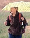 Eli Schulz uses an umbrella