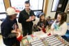 Laurel Hometown Troops pack Christmas goodies for those deployed